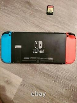 Good condition Nintendo Switch 32GB Neon Red/Neon Blue Console READ DESCRIPTION
