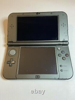New nintendo 3ds xl black handheld game console good condition with charger