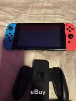 Nintendo Switch Neon Red and Neon Blue Joy-Con Console Used In Good Condition