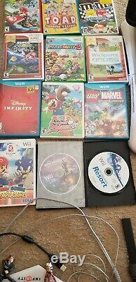 Wii u console bundle 32G used in good condition with 15 games + 2 downloaded