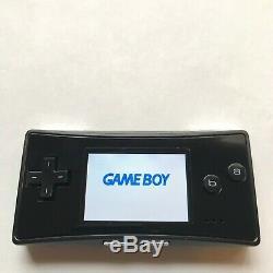 Game Boy Micro Oxy-001 Noir Avec Chargeur Faceplate Bon État Quelques Rayures