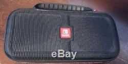Nintendo Console Switch En Très Bon État Avec 3 Jeux