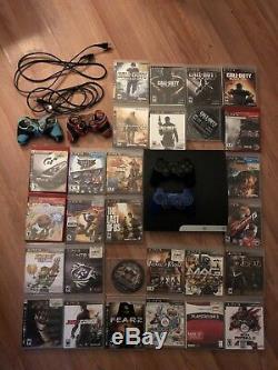 Sony Playstation3 Avec 30 Jeux Et 2 Manettes. Très Bonne Condition